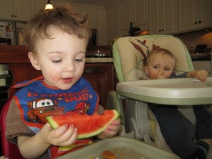 Eating the watermelon.